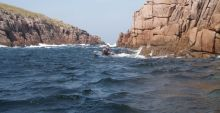 Kayaking under the red granite cliffs, Umphin Island, Co.Donegal.